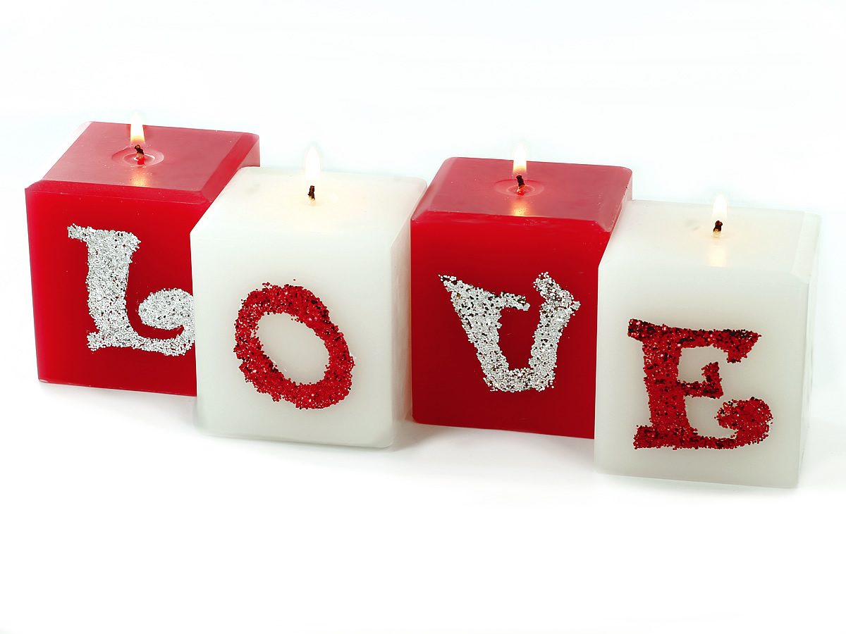 Learn how to make glitter LOVE pillar candles.